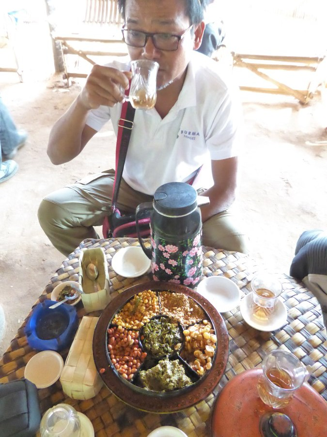 And this is AK. He is our age and shares with us his not-always-easy life in Myanmar. Here he enjoys tea with the customary assortment of nuts and seeds and spices.