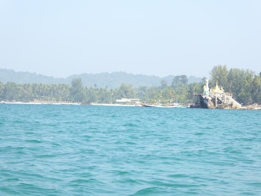 And we look back at Ngapali Beach ... with a Buddhist Stupa that from a rocky outcrop provides protection.