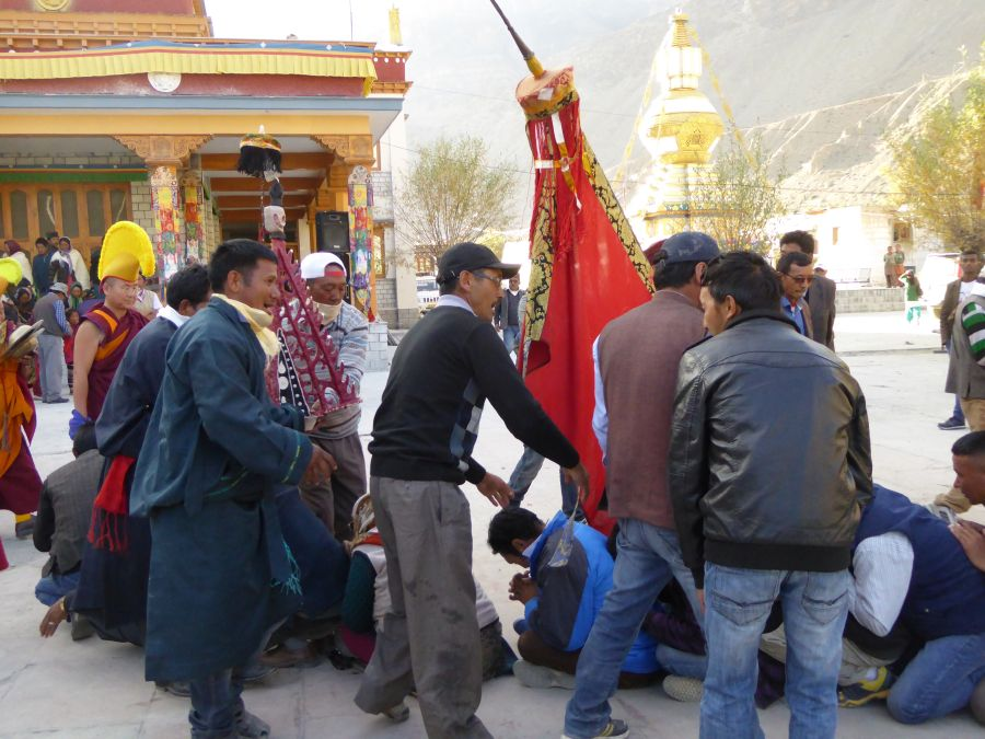 The locals bow down to the monks