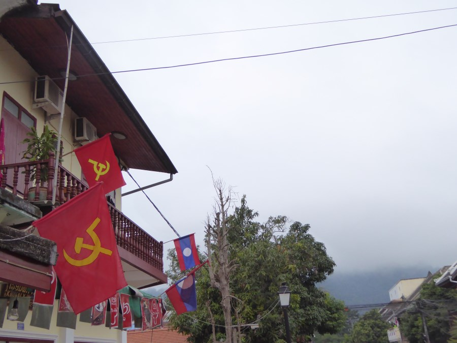 The Laos National Flag flies side by side with the Hammer and Sickle everywhere. The Lao Peoples Democratic Republic has been in power since 1975.
