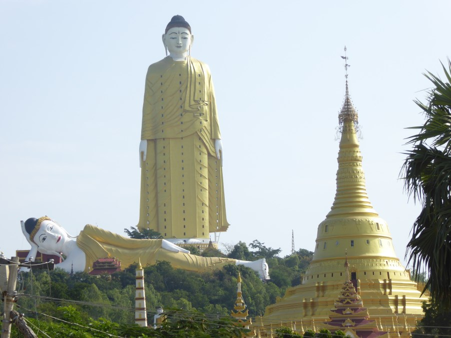 At the feet of the Standing Buddha there is the slightly smaller, but still enormous, Reclining Buddha. And a temple.
