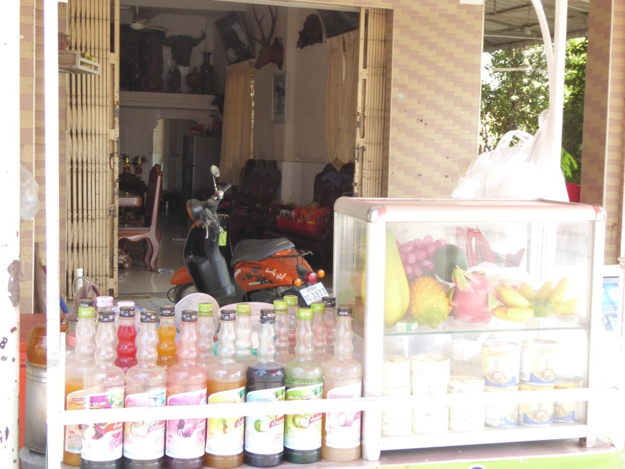 This house shop offers fresh fruit and  juices. See the home in the background.