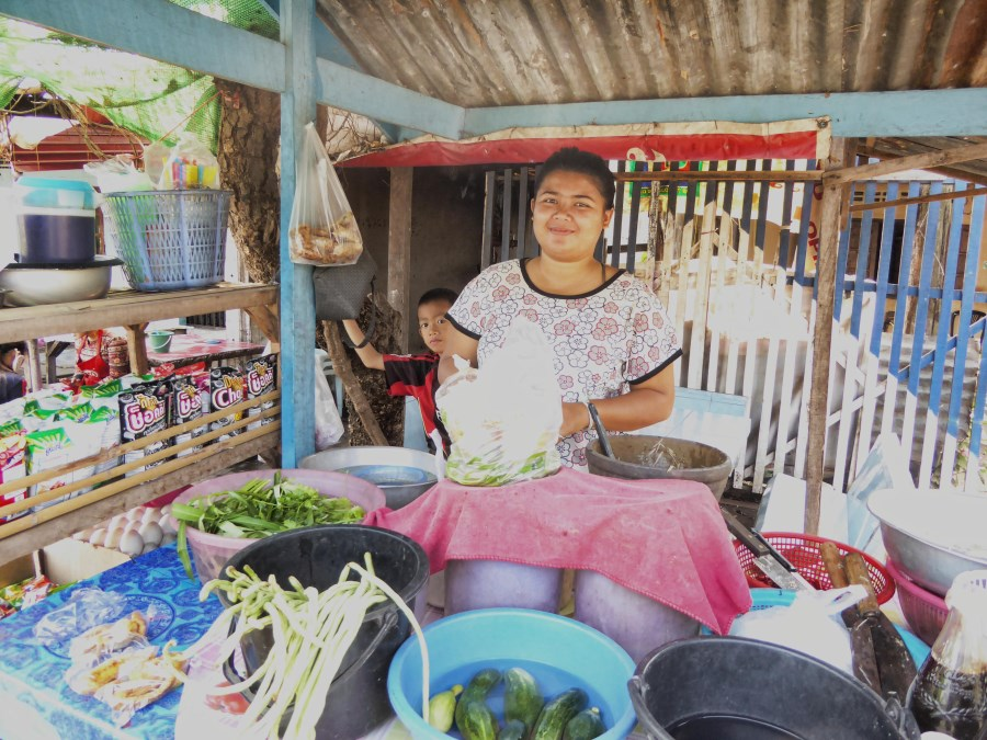 And here we buy delicious take away salads. This young girl has set up a makeshift stall in front of the family house.