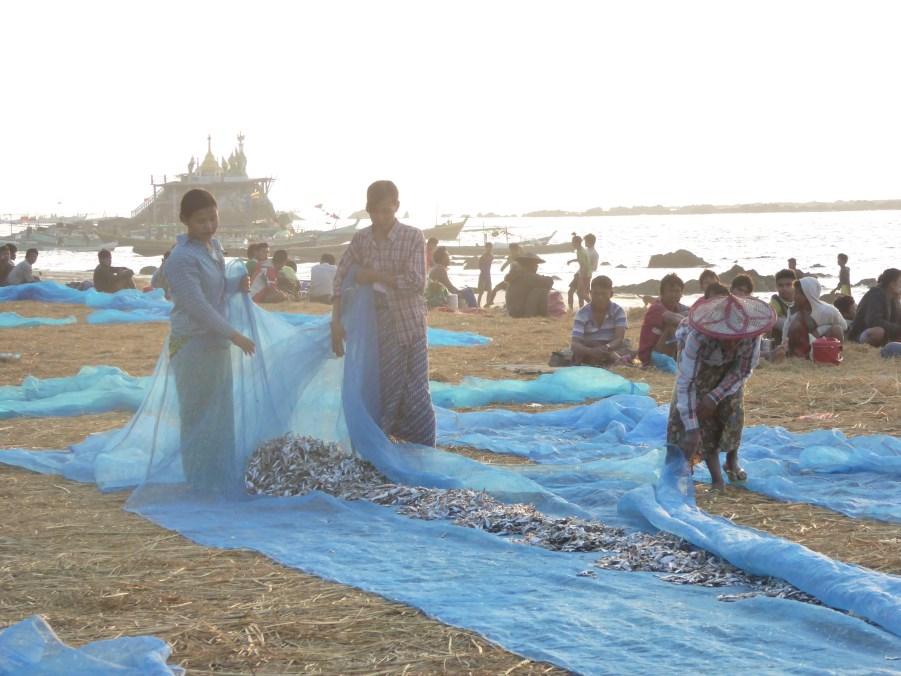 During the day, women dry fish caught the previous night.