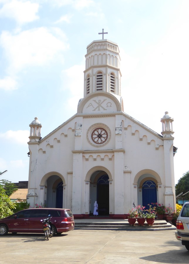 It is a Sunday and it is my 50th birthday. We attend a mass in a Catholic Church - the Cathedral of St Teresa in the town of Savannakhet.