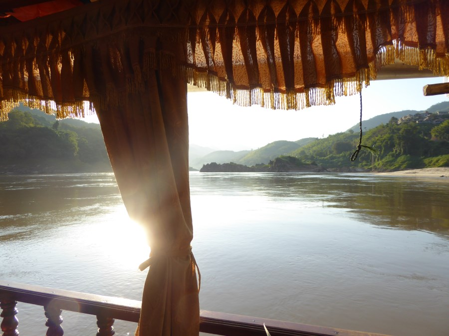 The sun cuts through the mist .... and we make our way from Pakbeng to Luang Prabang.
