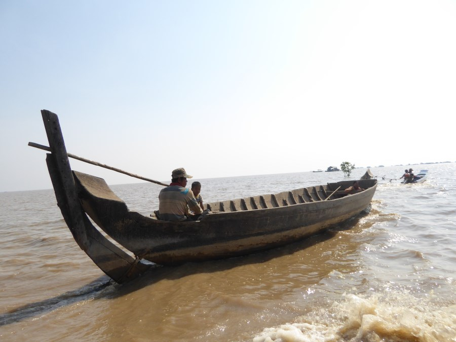 We head off, in our own boat, to the Vietnamese floating village. You can see it in the distance.
