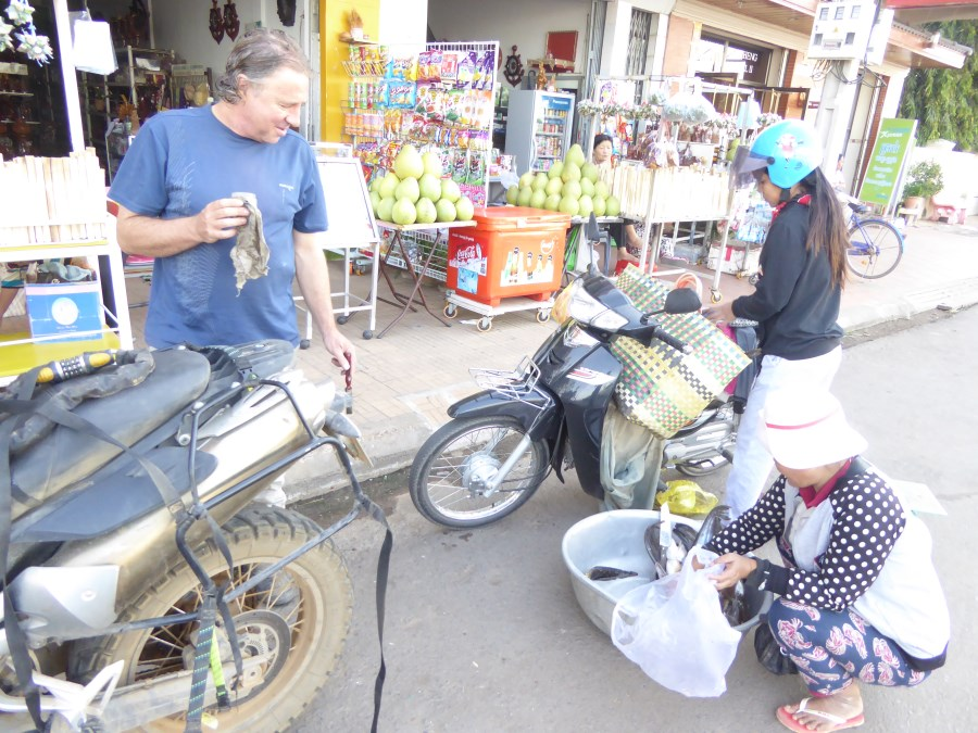 But above all, we cherish the resourceful people we meet in the streets. This fishmonger on a motorbike pulls up next to Harry ...