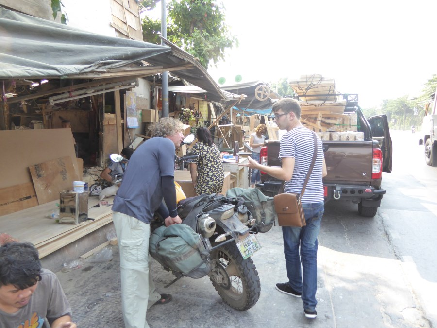 And we go shopping for crates so that our bikes can go home by ship. Here Harry stands with frenchmen Luc who will clear the bikes through Customs.
