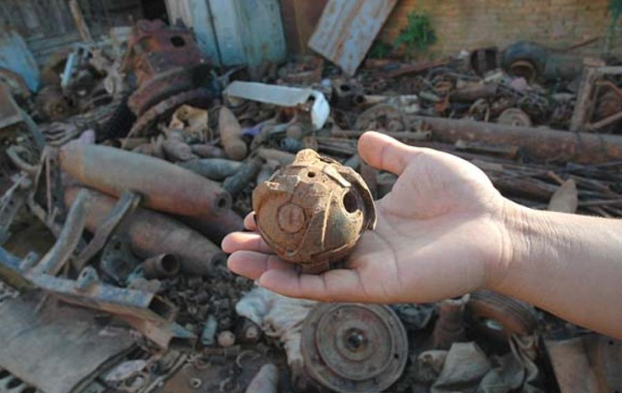A  Bombie and other bombs in a scrap yard