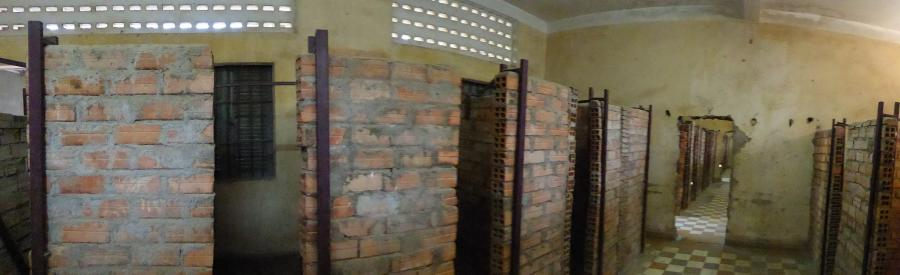 S21 was converted from a school to a prison .  These cells housed 30-40 prisoners who were unable to lie down due to so many being cramped into one cell